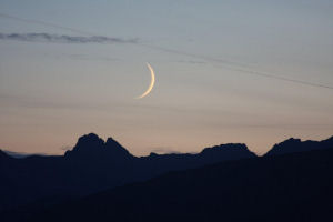 Photograph by Eileen Armstrong of the Cuillin Hills on the Isle of Skye and a 2.5-day old Moon on 14/06/2010 at 23:00 (BST)